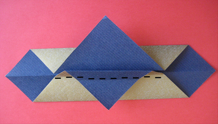 Fold the top of the flap you just made along the center crease under it.