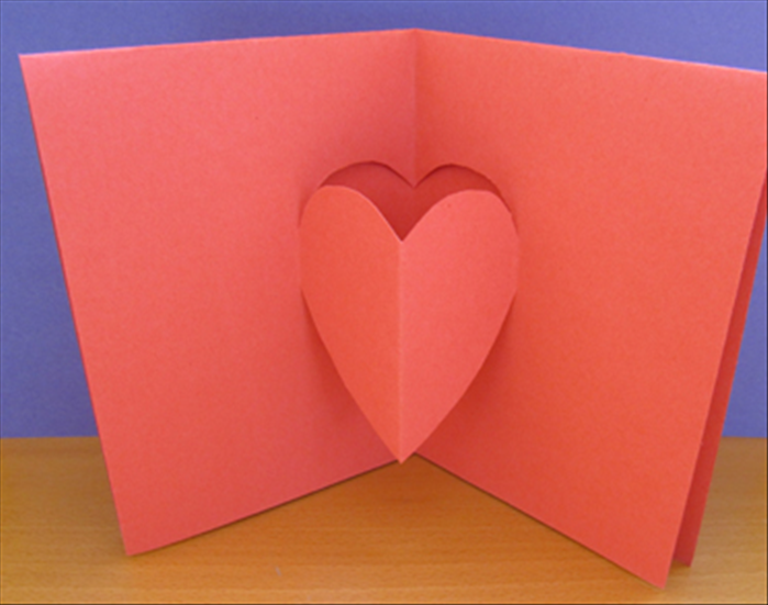 Result. The background folds in and the heart folds out. Close the card, press it down to crease it sharply and your popup heart card is ready to decorate and for your message.