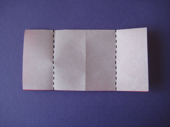 The folded edge should be on top.