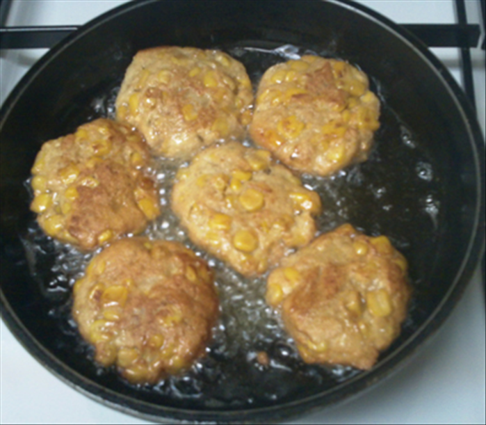 Fry the patties in oil over medium low heat until golden brown on the bottom 