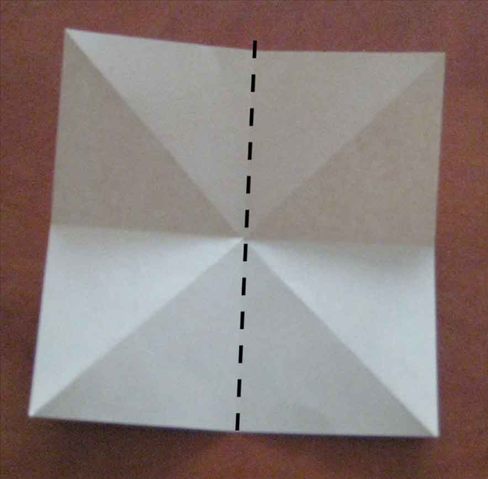 Fold the paper in half vertically and unfold.
