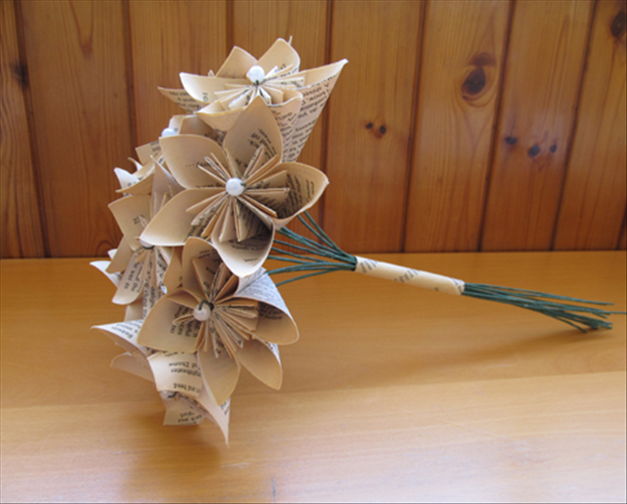 Insert the flower stems into the tube and adjust the flowers to form a slight dome shape.