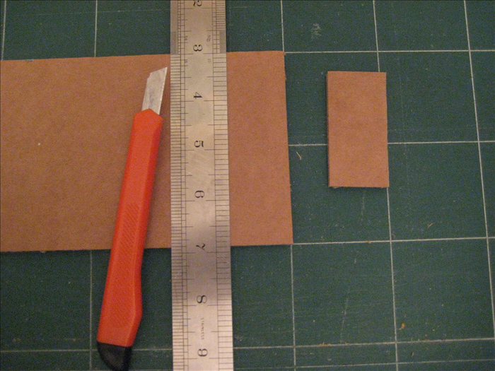 Cut 28  rectangles of cardboard 2 1/2 inches X  1 1/4 inches.