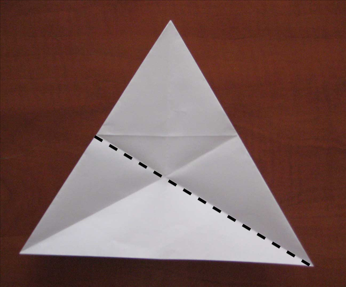 Bring the right bottom point up to the top point to fold in half Unfold